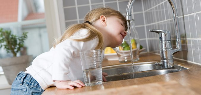 Kid Drinking Water from Faucet
